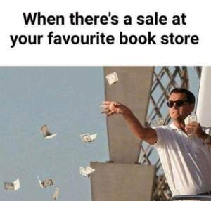 Man throwing money away for a book sale